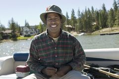 Happy Man On A Fishing Trip Royalty Free Stock Images