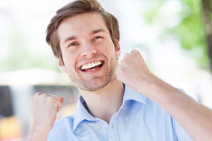 Happy man with fists clenched Royalty Free Stock Photography