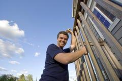 Happy Man Fixing House - Horizontal Royalty Free Stock Photo