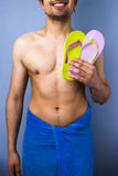 Happy man with flip-flops going to the beach Stock Photos