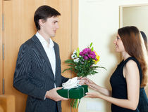 Happy man with flowers and gift box Royalty Free Stock Photos