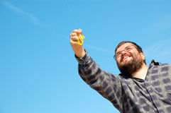 Happy man flying a kite Stock Image
