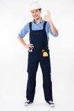 Happy man foreman in helmet standing and showing ok gesture Stock Photo