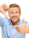 Happy Man framing a photograph portrait white background Stock Images