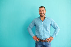 Happy man in front of turquoise wall Royalty Free Stock Images