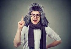 Happy man in furry hat having idea stock photos