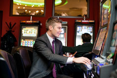 Happy man gambling Stock Photography