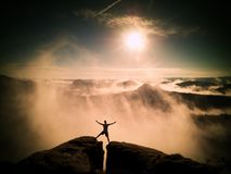 Happy man gesture raised arms. Funny hiker with raised hands Stock Photography