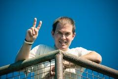 Happy man gesturing v sign Stock Photo