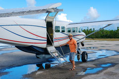 Happy man gets into a private plane on the islands Royalty Free Stock Images