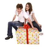 Happy man and girl with gift box. Stock Images