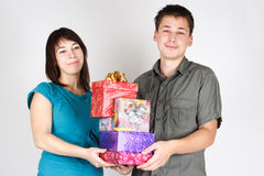 Happy man and girl holding many gifts Royalty Free Stock Photography