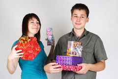 Happy man and girl holding many gifts Stock Images