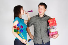 Happy man and girl holding many gifts Royalty Free Stock Image