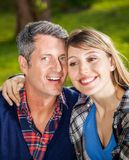 Happy Man With Girlfriend At Campsite Royalty Free Stock Photo