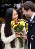 Happy man giving flowers to smiling woman Royalty Free Stock Photo