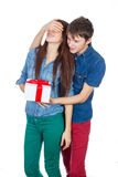 Happy Man giving a gift to his Girlfriend. Happy Young beautiful Couple isolated on a White background. Stock Images