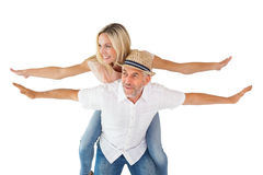 Happy man giving his partner a piggy back Royalty Free Stock Photos