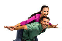 Happy man giving piggy back to his girlfriend. Happy men giving piggy back to his girlfriend on white screen Stock Images