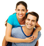 Happy Man Giving Piggyback Ride To Woman Royalty Free Stock Images