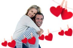 Happy man giving piggyback to woman Royalty Free Stock Photo