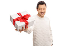 Happy man giving a present Royalty Free Stock Photos