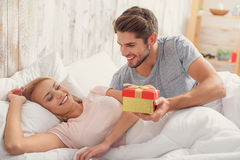 Happy man giving present to his wife Royalty Free Stock Photography