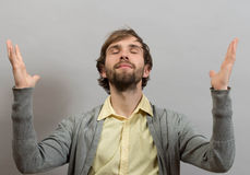 Happy man giving thanks to God raising his hands. With a smile in thanksgiving, part of a series on body language, isolated Stock Images