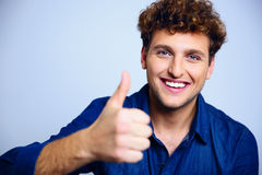 Happy man giving thumbs up Stock Photo