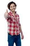 Happy man giving thumbs up sign Stock Photo