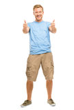 Happy man giving thumbs up sign - full length portrait on white Royalty Free Stock Photography