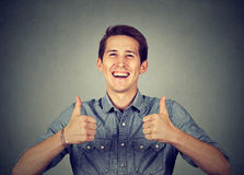 Happy man giving thumbs up sign royalty free stock photos