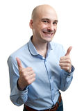 Happy man giving thumbs up sign Stock Photography