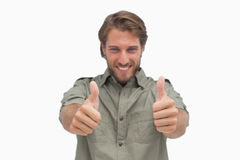 Happy man giving thumbs up to camera Royalty Free Stock Photo