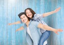 Happy man giving woman piggyback Stock Image