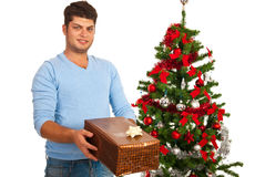 Happy man giving Xmas present Royalty Free Stock Photo