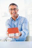 Happy man with glasses showing model house Royalty Free Stock Photography
