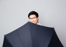 Happy man in glasses with umbrell Stock Photos