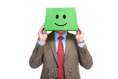 Happy man with a green box on a head Stock Photo