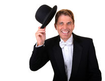 Man in tuxedo with hat celebrating Stock Photos