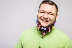 Happy man with hair clips Stock Photography