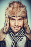 Happy man with half shaved face beard in fur hat. Royalty Free Stock Photo