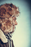 Happy man with half shaved face beard in fur hat. Royalty Free Stock Image