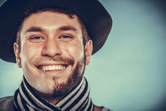 Happy man with half shaved face beard hair in hat. Royalty Free Stock Image
