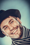 Happy man with half shaved face beard hair in hat. Stock Images