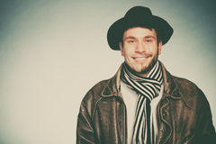 Happy man with half shaved face beard hair in hat. Royalty Free Stock Images