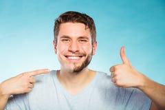Happy man with half shaved face beard hair. Stock Photos