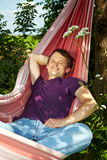 Happy man in hammock Stock Photos