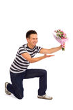 Happy Man Handing Over Flowers Royalty Free Stock Photo