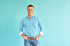 Happy man with hands in pockets Stock Photos